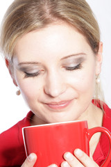 Woman enjoying a mug of coffee