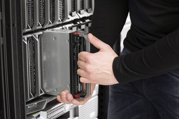IT Engineer installs Blade Server in Data Center