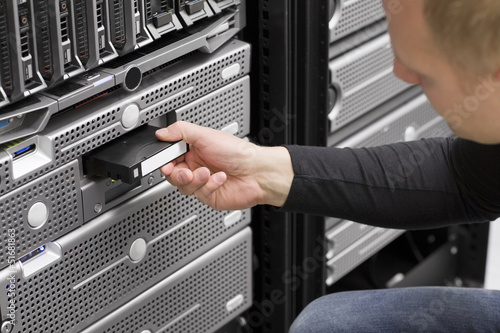 IT Engineer Inserts Backup Tape