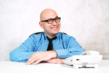 Smiling businessman with telephone