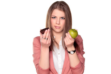 teenager girl holding apple and chocolate cake in her hands