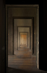 Closed door at the end of the hallway, rite of passage concept.