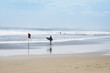 surfer walking kuta beach bali