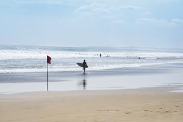 surfer walking kuta beach bali