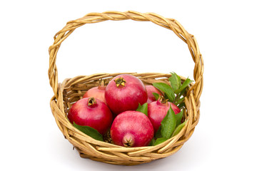 fresh pomegranates in a basket