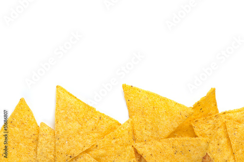 edge of tortilla chips on white background