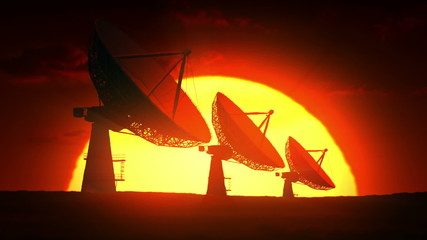Satellite dishes at sunrise