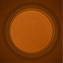 Leather background with round stitched labels