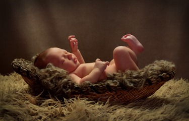 Baby in a Basket Kicking