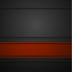 Red leather stripe on black leather background with copyspace