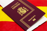 Spanish passport on spanish flag background