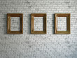 Three empty wooden frames