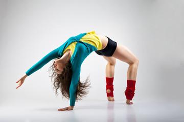 Modern style dancer  posing on grey background
