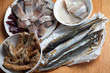 Assorted fish on wooden table. Top view