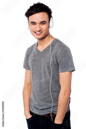 Young guy enjoying music