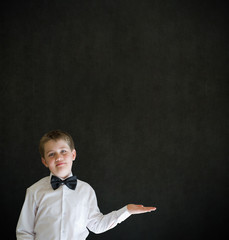 Boy dressed up as businessman holding anything on flat hand