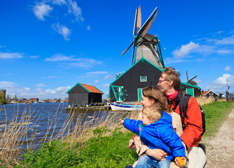 family near windmill in Holland