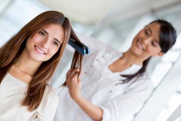 Stylist straightening hair