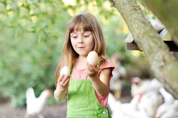 portrait of a little girl with eggs