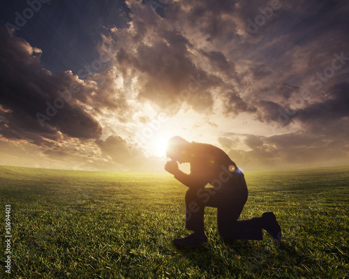 Praying at sunset