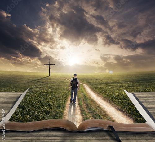 Leinwanddruck Bild Man walking on Bible