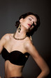 Beauty in Black Bra. Gold Jewelery.  Necklace and Earrings