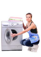 A pretty young woman doing laundry