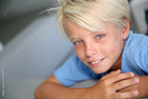 Portrait of young boy with blue eyes and shirt