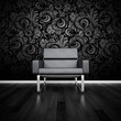 Modern black design chair in front of dark wall