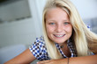 Portrait of smiling blond teenager