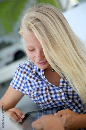 Portrait of teenager using digital tablet
