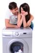 beautiful young couple with a washing machine