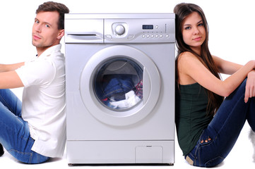 beautiful young couple with a washing machine