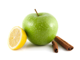 Isolated green apple with lemon and cinnamon