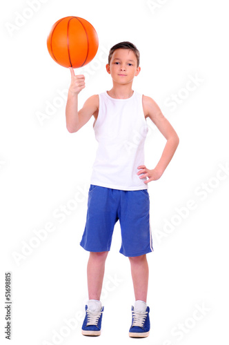 child playing basketball