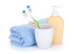 Two colorful toothbrushes, liquid soap and towel