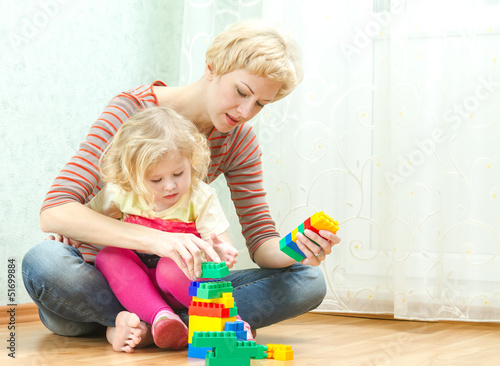 Mother with a little daughter playing
