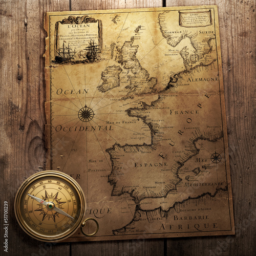 old compass on vintage map 1666