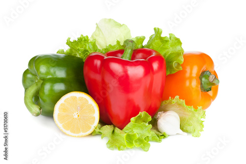 Colorful bell peppers with lemon and lettuce