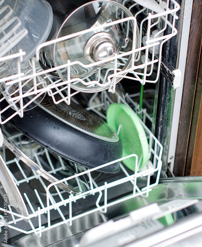 Open dishwasher after cleaning