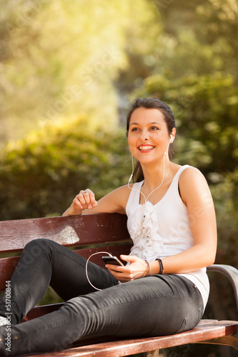 young latin woman using cellphone