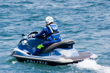 Policewoman with watercraft