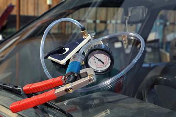 Damaged windshield repair vacuum pump equipment
