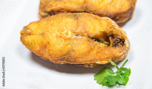 Portions of deep fried red snapper fish.