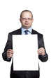 Young man holding a blank sheet of paper vertical
