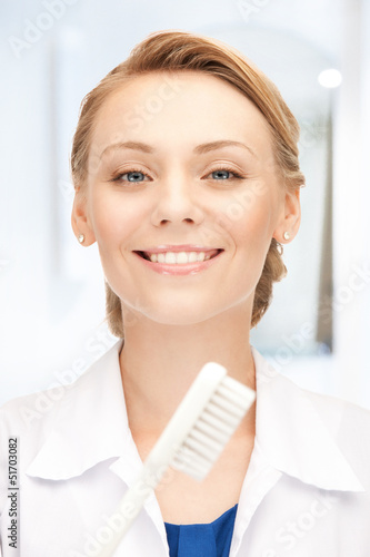 attractive female doctor with toothbrush