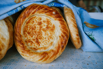 Traditional eastern lepeshka nan - white flat bread baked in old