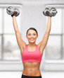 woman with heavy steel dumbbells