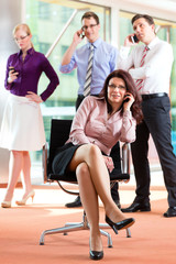 Business people - boss and employees in office