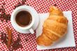 Coffee with croissant and cinnamon